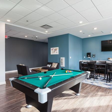 Residents Playing Billiards | Apartments Homes for rent in Kent, OH | 345 Flats
