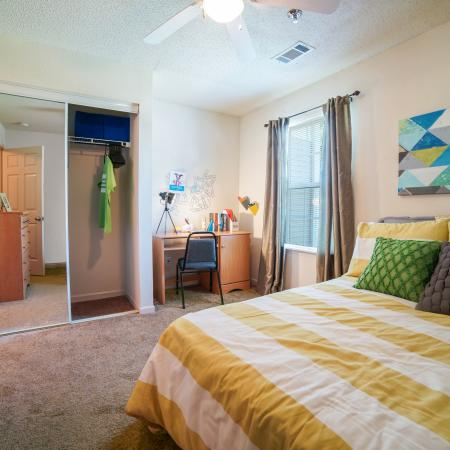 Residents Relaxing in Student Bedroom | Murfreesboro TN  Apartments | Student Quarters Murfreesboro - Hazelwood