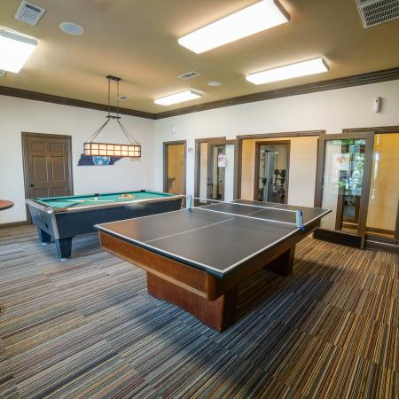 Residents Playing Ping Pong | Apartments for rent in Chicago, IL | Student Quarters Murfreesboro - Rutherford