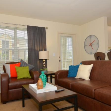 Residents Lounging in the Living Room | Chicago IL Apartments For Rent | Student Quarters Murfreesboro - Rutherford