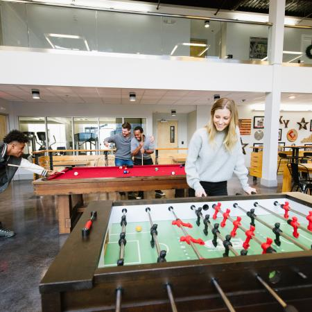 Residents Playing Fuseball | Louisville KY Apartment Homes | The Clubhouse