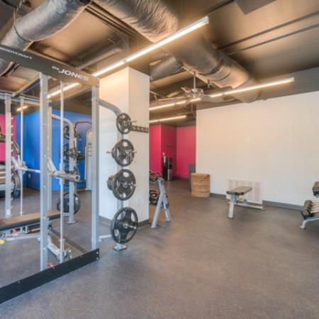 Residents Working Out at Fitness Center | Normal IL Apartment Homes | The Edge on Hovey