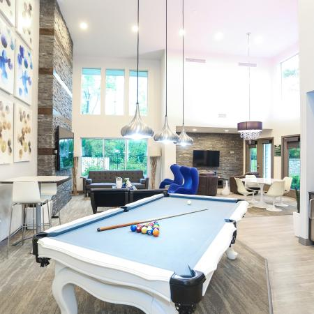 Residents Playing Pool | Apartment Homes in Lawrence, KS | The Rockland