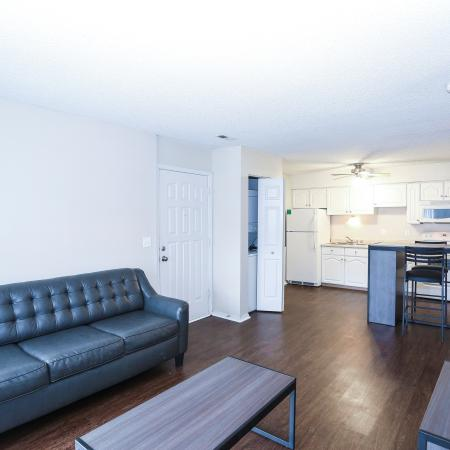 Residents Lounging in the Living Room | Lawrence KS Apartments For Rent | The Rockland