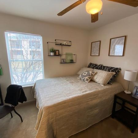 Residents Relaxing in the Bedroom | Mt Pleasant Apartments | University Meadows