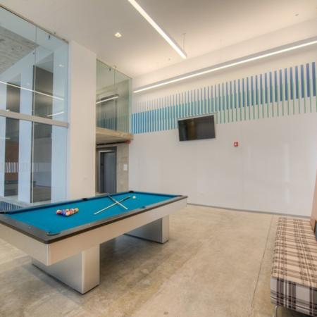 Residents Playing Pool | Apartment Homes in Chicago, IL | Vue 53