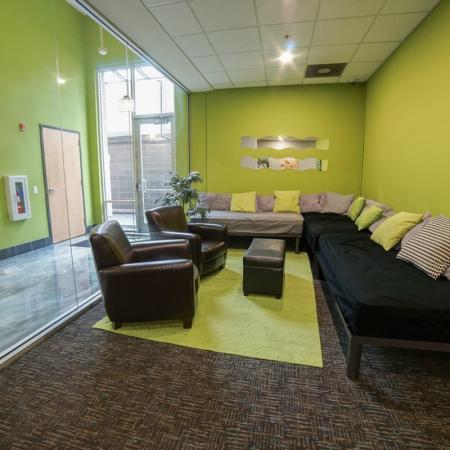 Residents Relaxing in Club Room | Chicago IL Apartment For Rent | Tailor Lofts