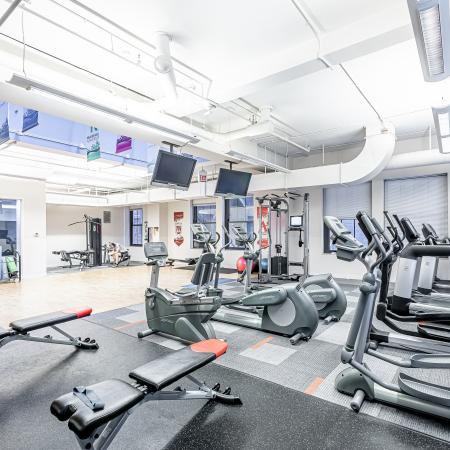 Residents Working Out at Fitness Center | Chicago IL Apartment Homes | The Buckingham