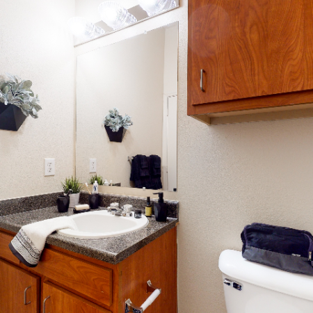 Bathroom vanity with large mirror | The Edge on Hovey | Apartments in Normal, IL