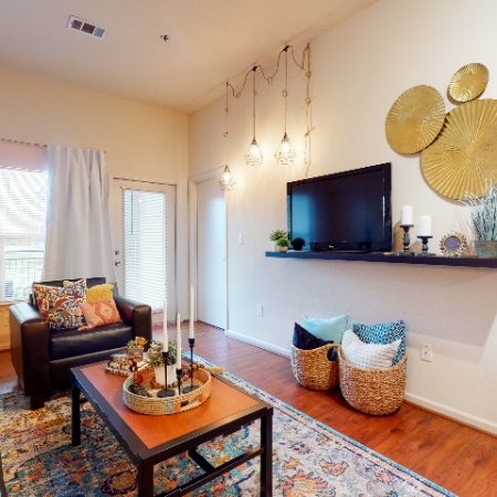 Roomy living space with large windows | The Edge on Hovey | Apartments in Normal, IL