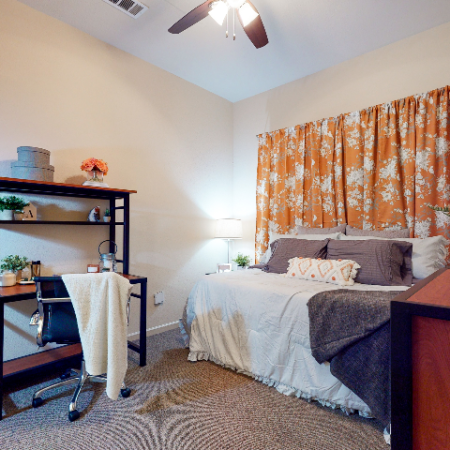 Bedroom with Ceiling Fan and Desk | The Edge on Hovey | Apartments in Normal, IL