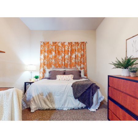 Carpeted Bedroom with Desk | The Edge on Hovey | Apartments in Normal, IL
