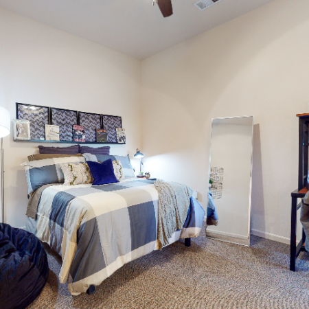 Bedroom with carpet & ceiling fan | The Edge on Hovey | Apartments in Normal, IL