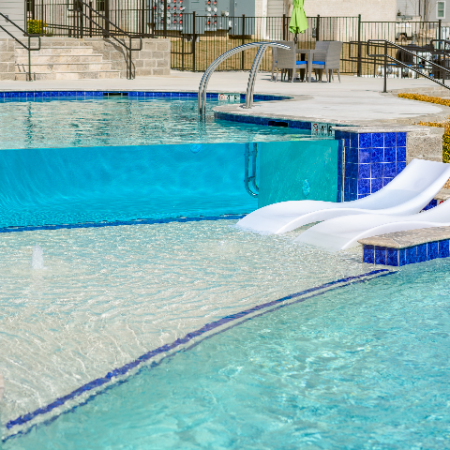 Resort Style Pool with In-pool Loungers   Campion at Lafayette   Lafayette, LA Student Apartments