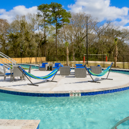 Resident Sun Deck in Center of Pool with Hammocks and Lounge Chairs   Campion at Lafayette   Lafayette, LA Student Apartments