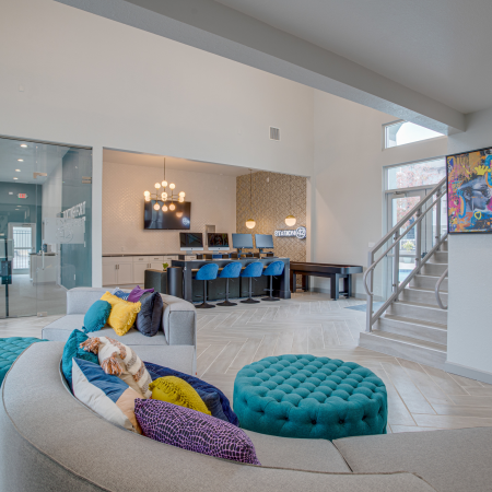 Community Lounge with Comfortable Seating and Modern Art at Station 42 | Tampa Student Apartments