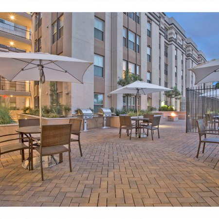 Paved Patio with Shaded Tables | 27 North | Apartments in San Jose