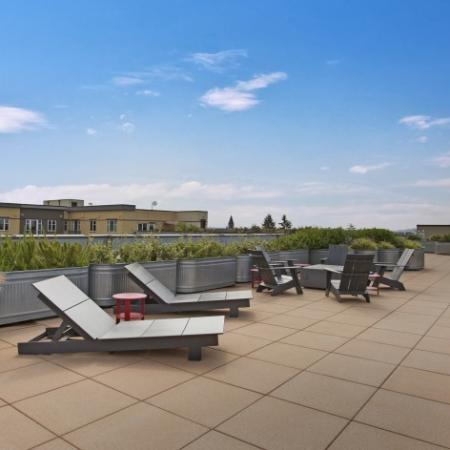 Rooftop Deck Lounge Chairs and Fire Pits Area
