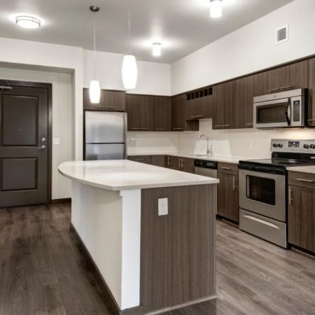 Residents Snacking in the Kitchen | Apartments For Rent Hillsboro Oregon | Tessera at Orenco Station 2