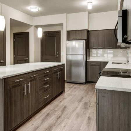 Residents Snacking in the Kitchen | Apartments For Rent Hillsboro Oregon | Tessera at Orenco Station