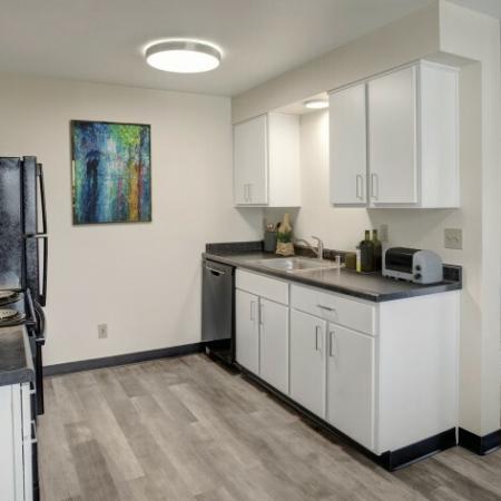 Heatherstone Renovated Kitchen Area with Black Appliances