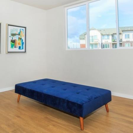 Plank-style flooring and Large windows in Bedroom | Outlook at Pilot Butte Apartments | Apartments Bend Oregon