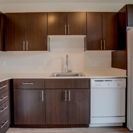 Kitchen with Over the Refrigerator Storage HANA Apartments | Apartments Seattle WA