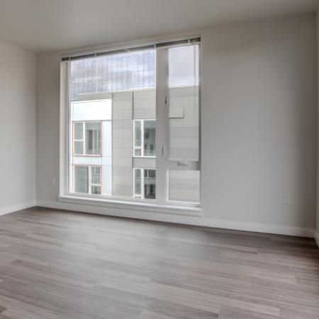 Spacious Living Area with Storage and Large Picture Windows | HANA Apartments | Apartments Seattle Wa