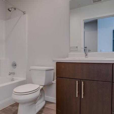 Bathroom with Tub/Shower Combination | HANA Apartments | Apartments Seattle WA