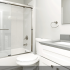 Renovated bathroom with glass sliding door for tub/shower
