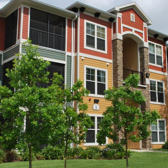 Oakleaf Village Apartments, exterior, red, orange, green exterior, three levels, trees