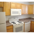 Oak Tree Sample Kitchen with White Oven and Microwave | Newark Apartments DE