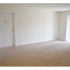 Oak Tree Sample Living Room with Door | Newark Apartments DE