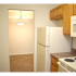 Oak Tree Sample Kitchen with white Refrigerator and Opening | Newark Apartments DE