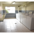 Winslow House Laundry Facilities with Light Shining in | Apartments near Blackwood, NJ