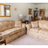 Carpeted model living room furnished with a couch and love seat at Upper Deerfield apartments in Bridgeton, NJ.
