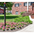 Newport Village Rental Office Sign with Bench and Purple Flowers | Levittown PA Apartments
