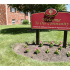 Newport Village Red Welcome Sign with Flowers | Levittown PA Apartments