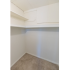 Walk-in closet with clothes rods and built-in shelves at The Lafayette at Valley Forge apartments in King of Prussia, PA.