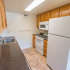 Model kitchen with tiled floors, wood cabinets and modern appliances at Princeton Orchards Apartments in Dayton, NJ.