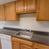 Model kitchen with tiled floors, wood cabinets and modern appliances at Princeton Orchards Apartments in South Brunswick, NJ.