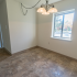 Model dining area with tiled flooring at Princeton Orchards Apartments in Dayton, NJ.