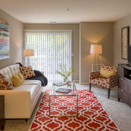 Residents Lounging in the Living Room | Reserve at Ballenger Creek