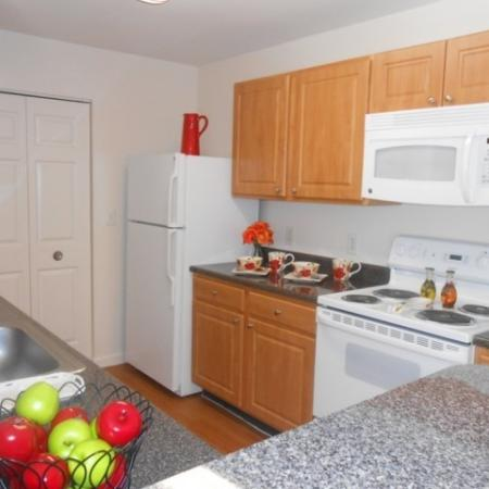 Residents Cooking in the Kitchen | Ft. Myers Florida Apartments | Mosaic at The Forum