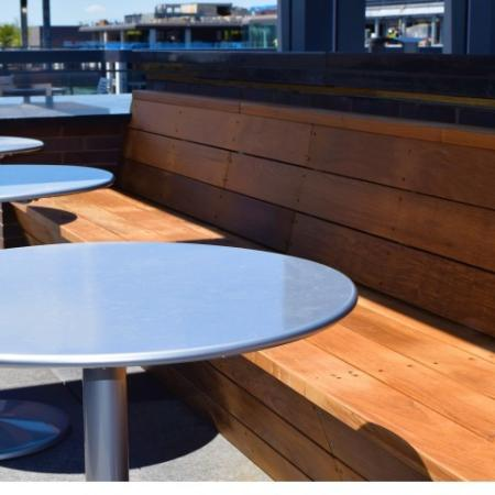 Rooftop Lounge With Seating For Dining & Large Screen TV Viewing
