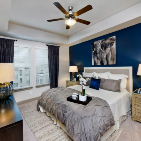 Elegant Master Bedroom with Ceiling Fan