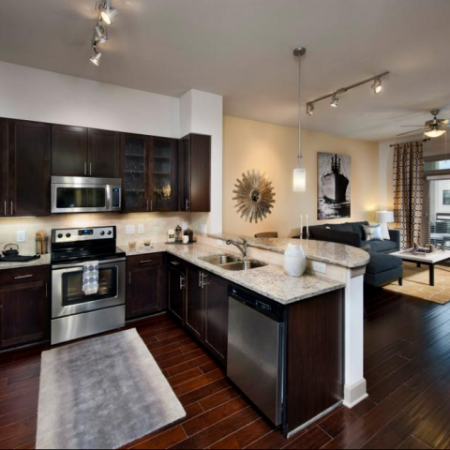 Luxurious Kitchen with custom maple cabinetry, granite countertops with elegant backsplash and stainless steel appliances