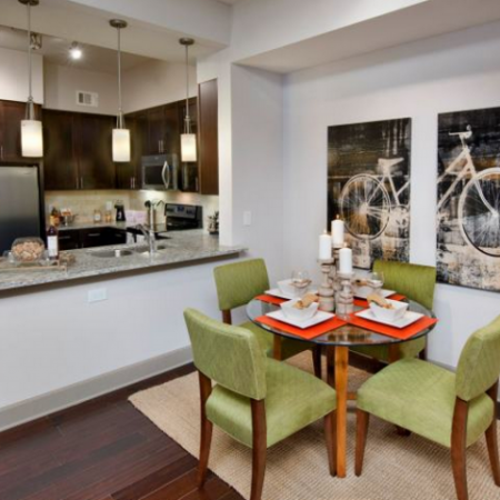 Spacious Dining Room and Kitchen with Pendant Lighting