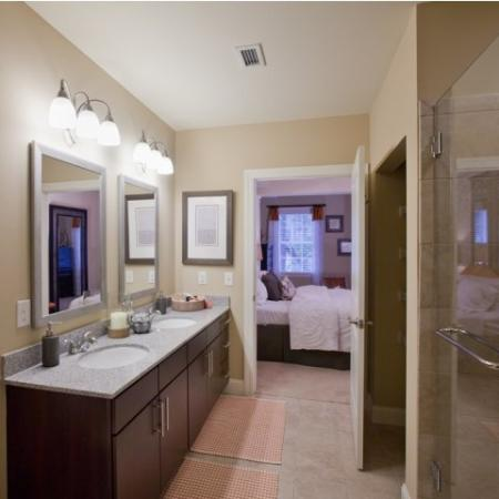 Classical bathroom with tile flooring and double sinks