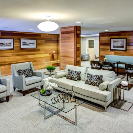 Furnished clubhouse lounge with wood paneling